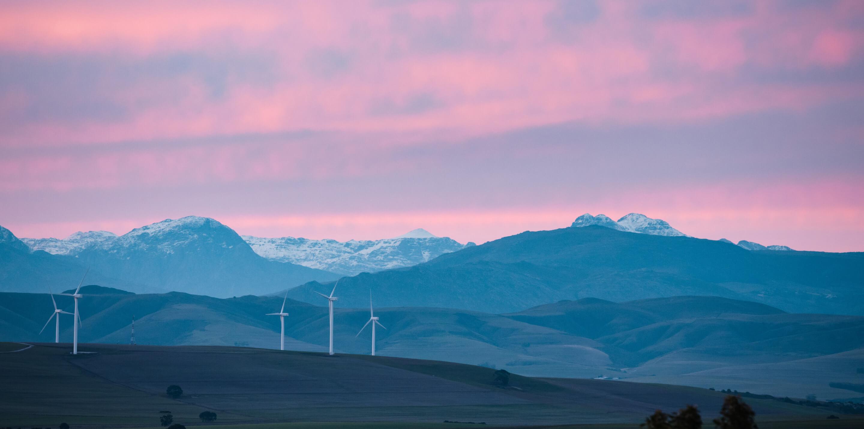 Beautiful landscape with windmill generators on a hill