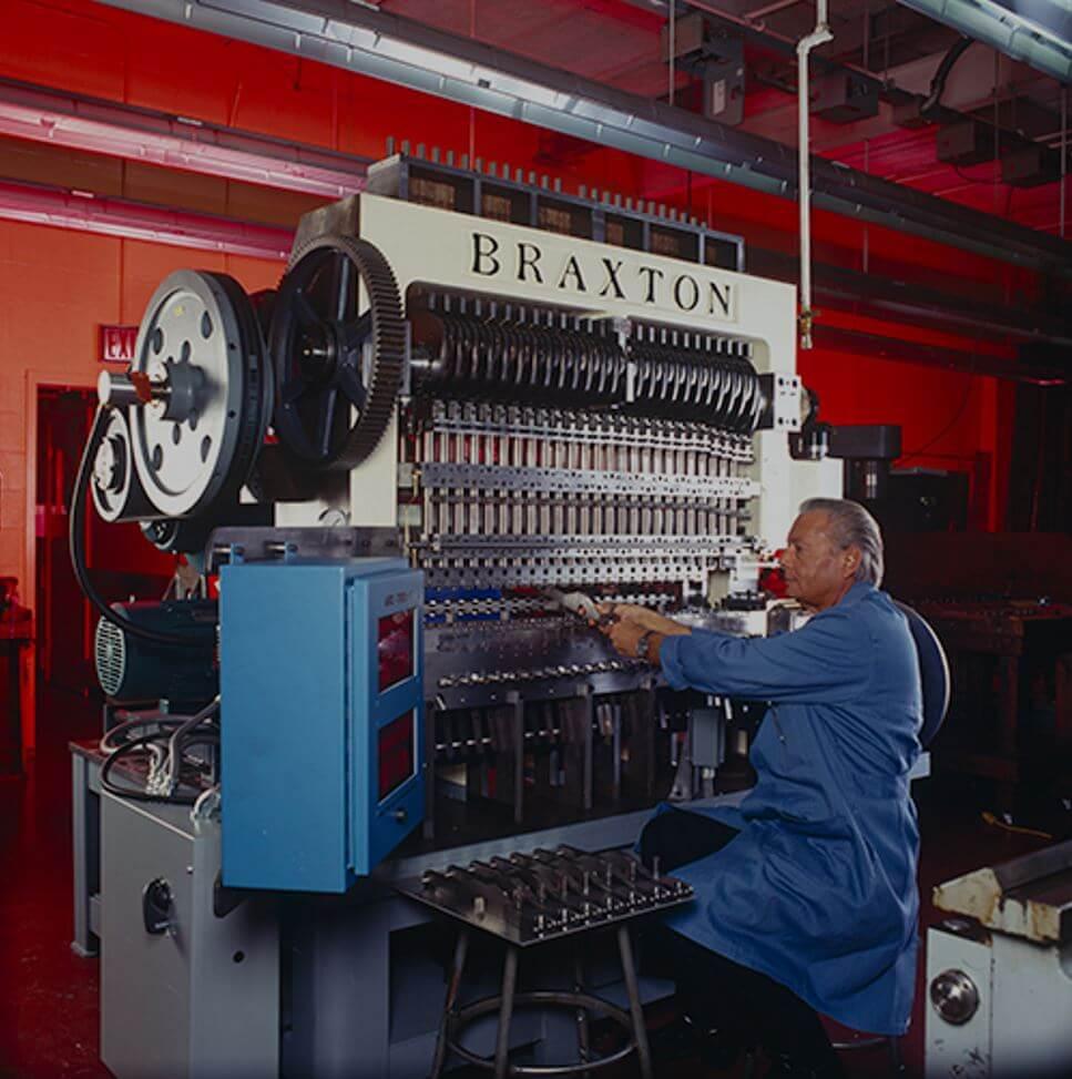 Braxton Nelson with a machine.