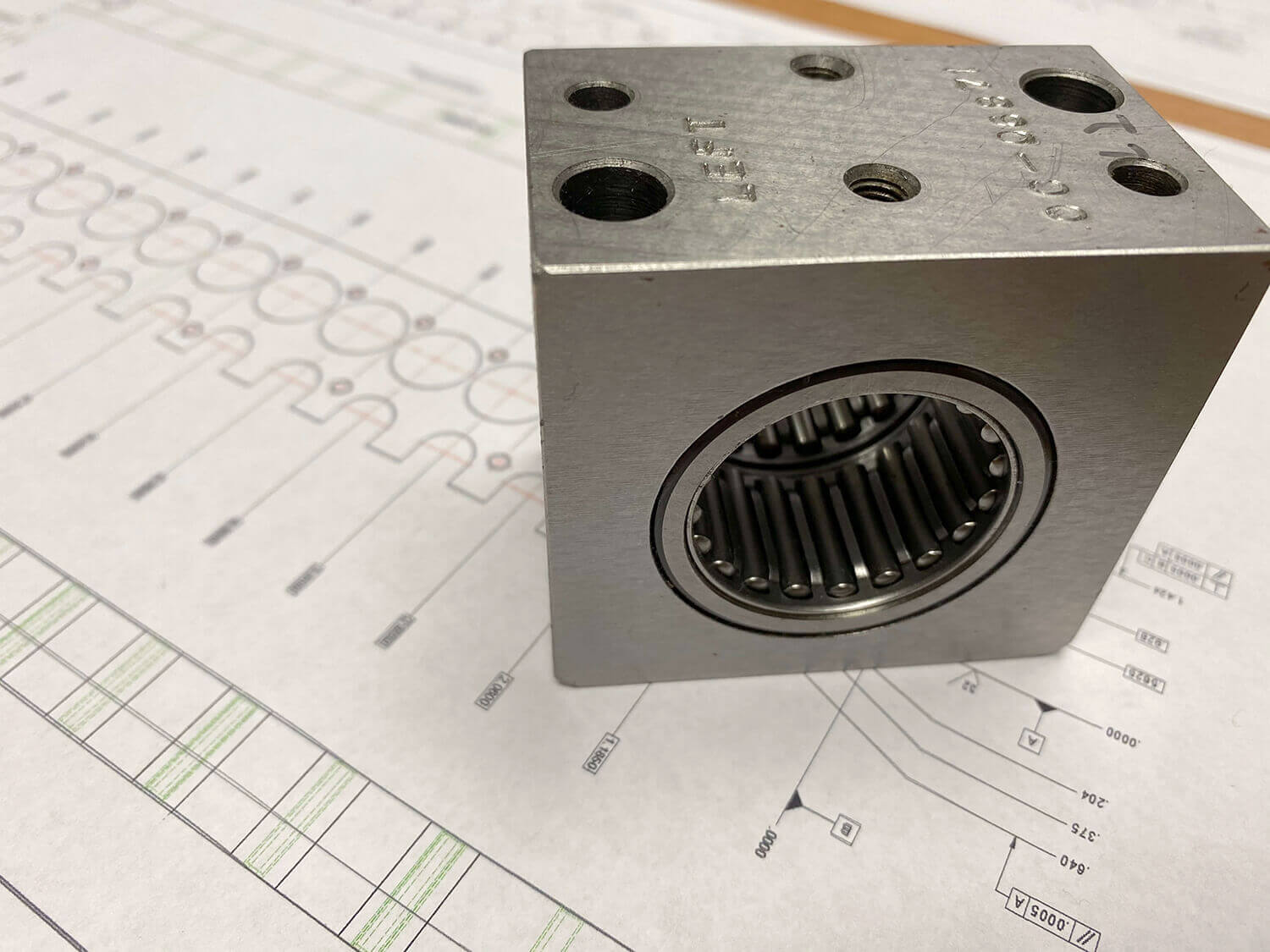 Picture of Braxton machine bearing block on top of a CAD drawing