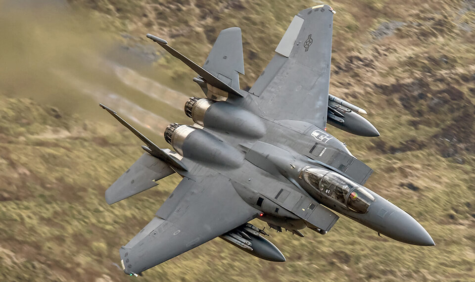 A jet flying low to the ground