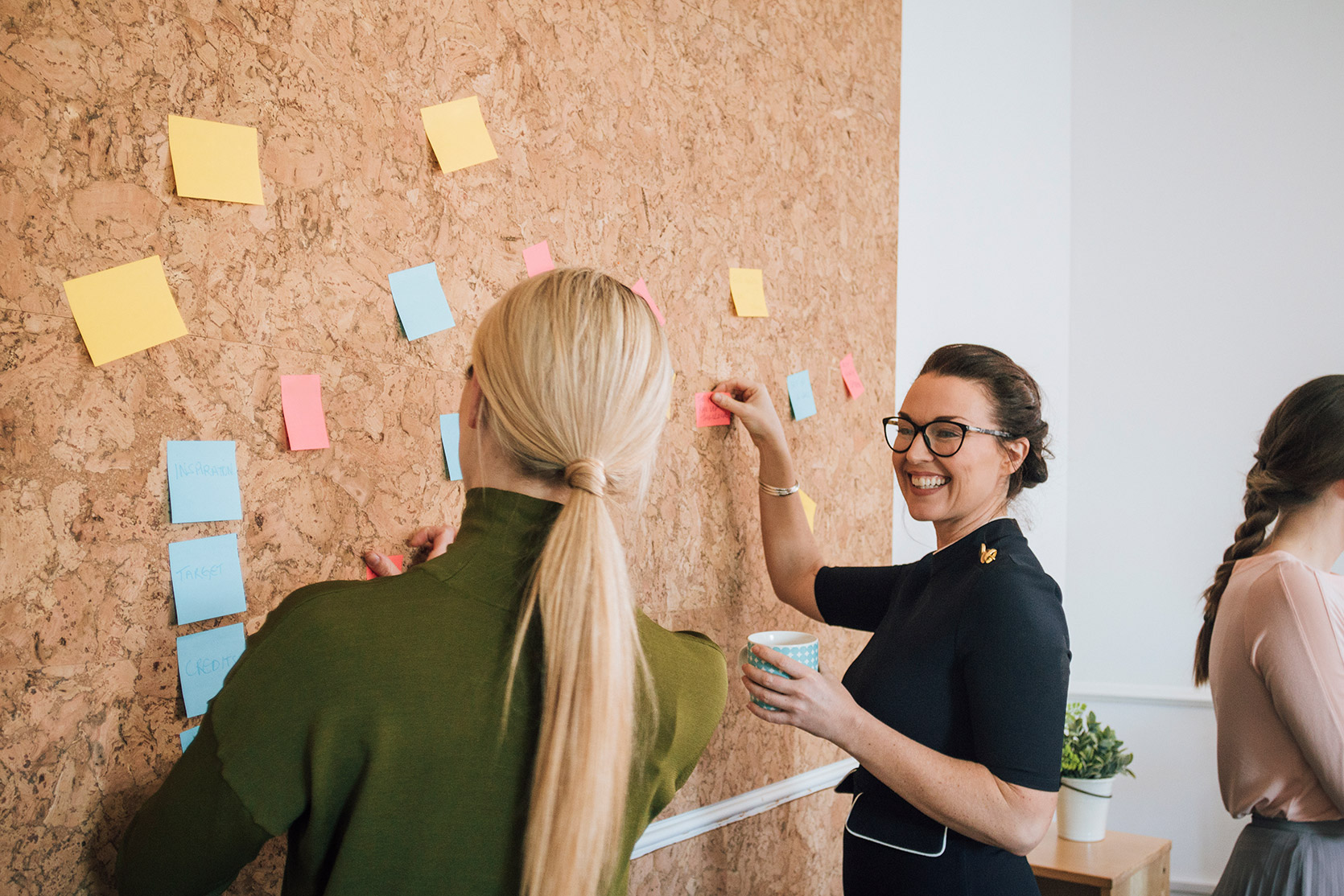 Changing from sole trader to limited company, image of people sticking notes on a cork board | Crunch
