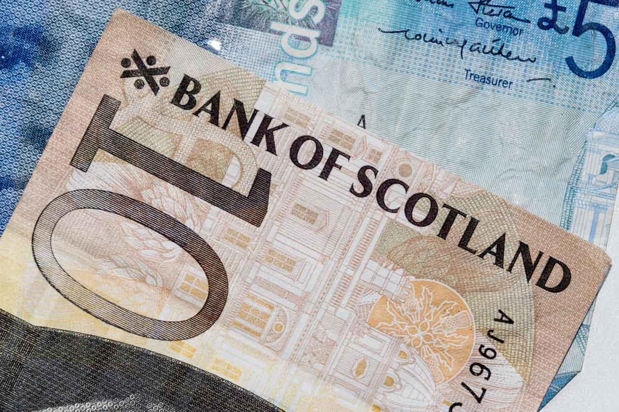 Scottish Income Tax Rates, image of Scottish money | Crunch
