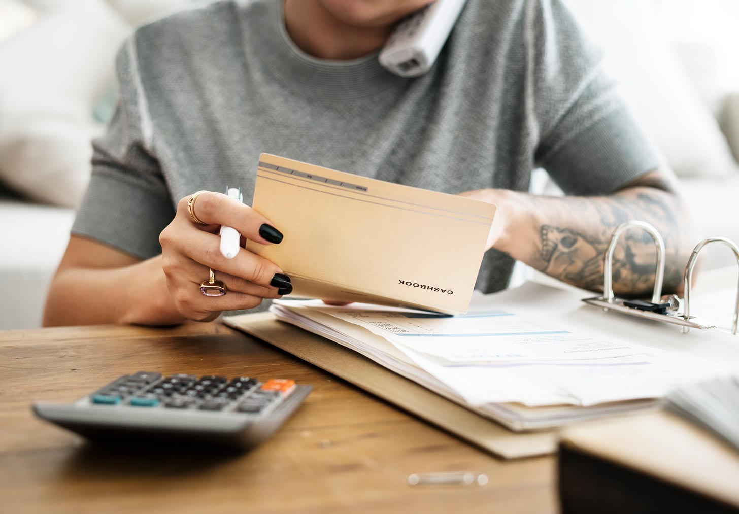 Freelancing on the side, image of a woman doing taxes | Crunch