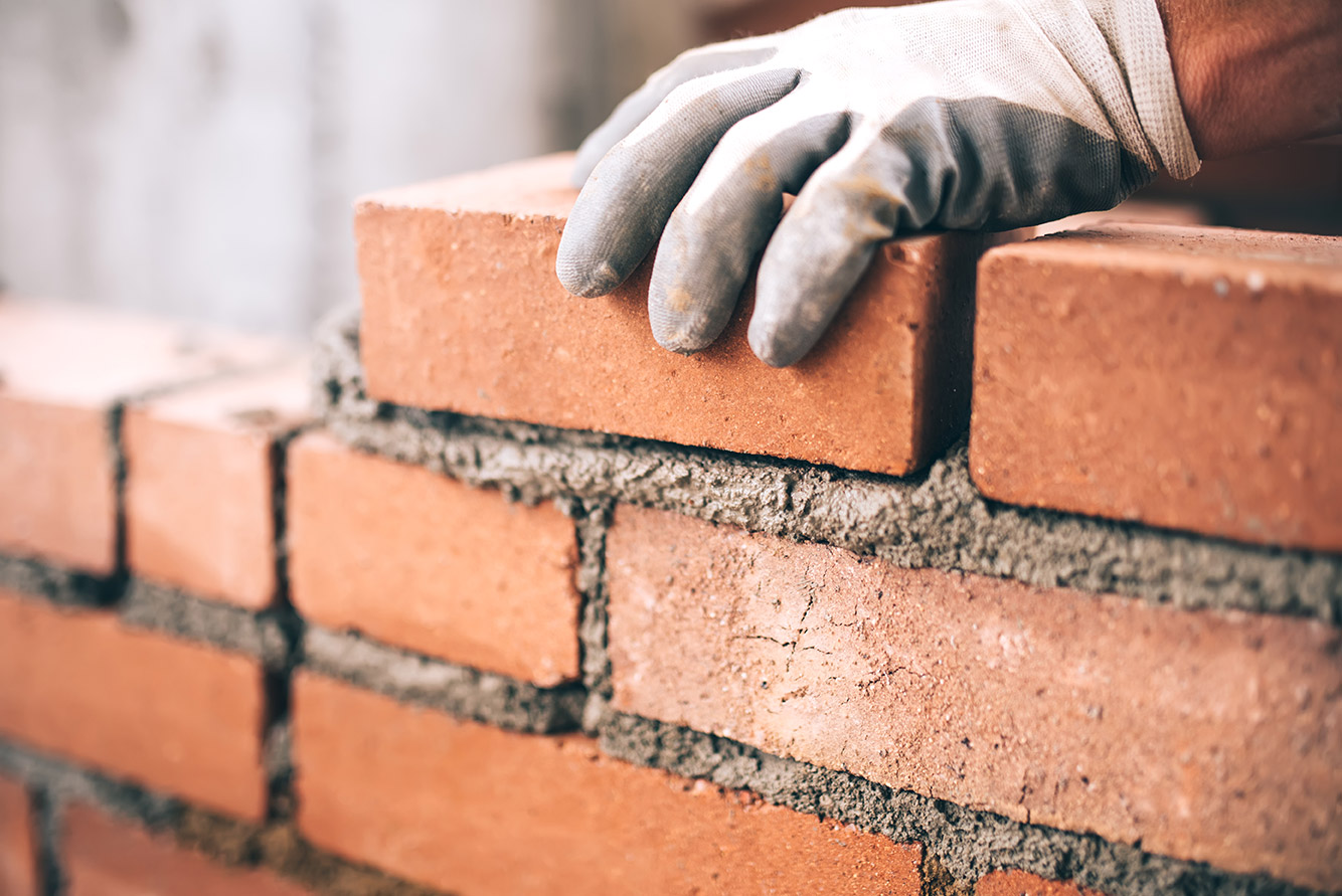 How to operate CIS as a limited company or a sole trader - Crunch - image of a bricklayer at work