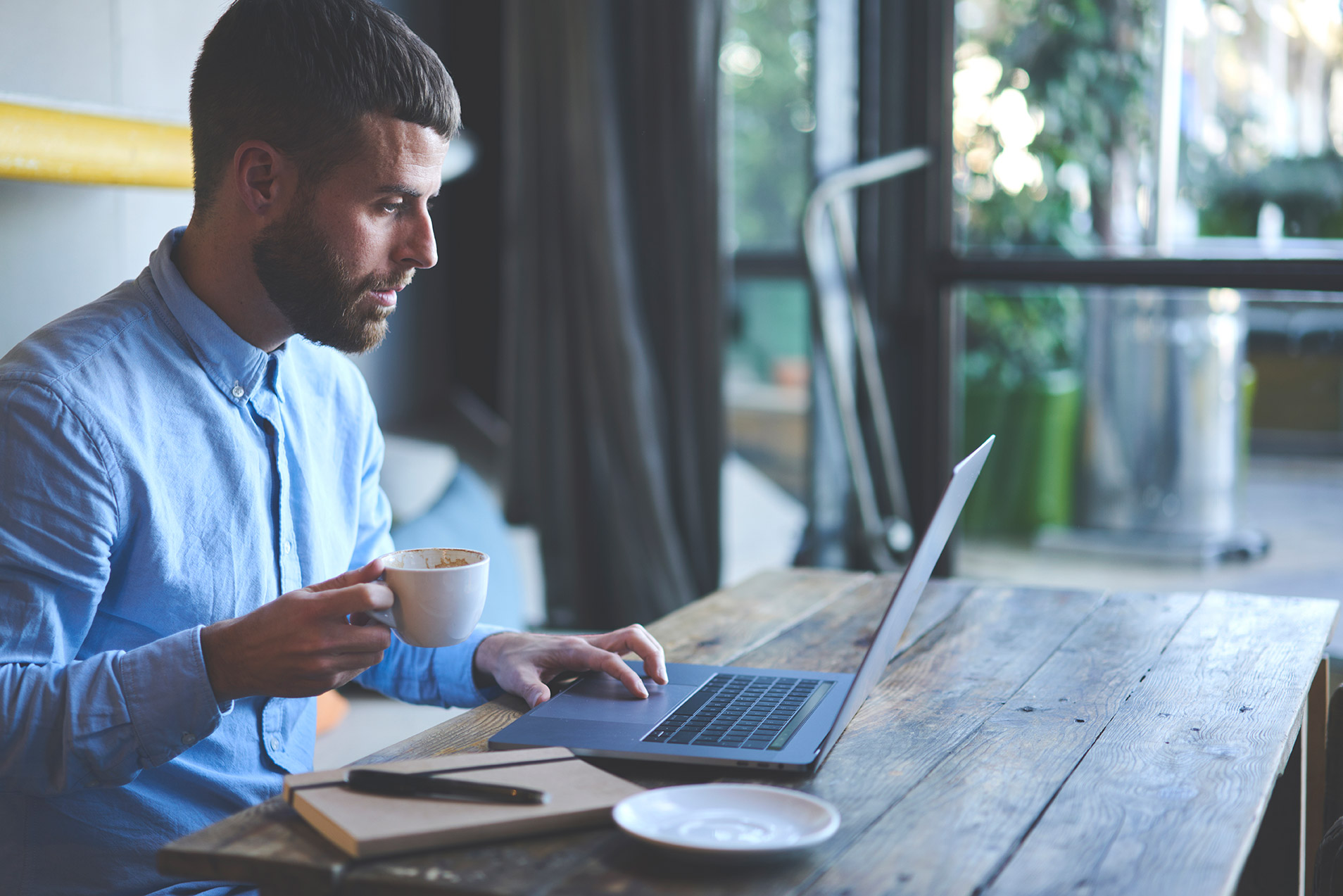 What are the main advantages of a limited company - Crunch - image of a man drinking coffee at a laptop