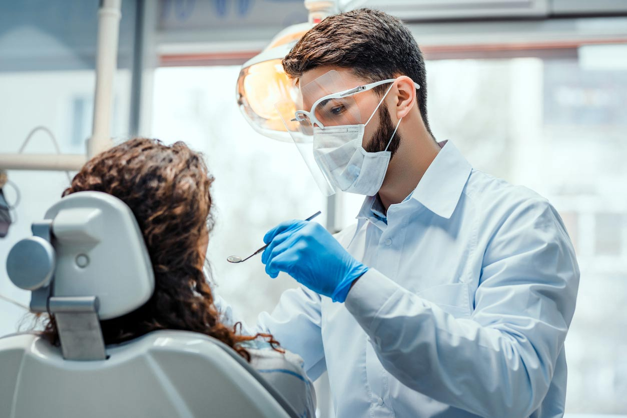 Managing your accounts and tax as a self-employed dentist, hygienist, or dental therapist - Crunch - image of a dentist