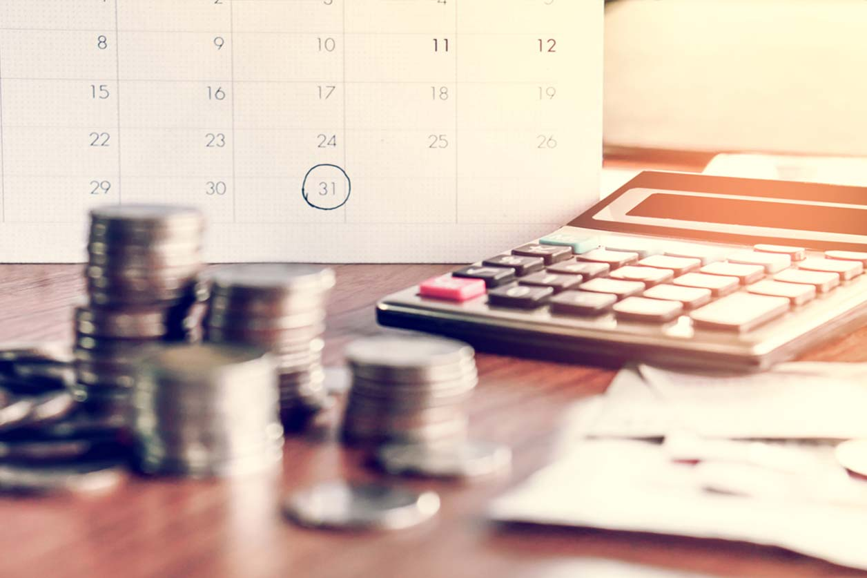 Self Assessment: What happens if I miss the deadline?, image of coins on a table | Crunch