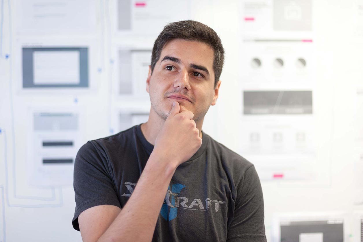 How to come up with a great company name, image of someone thinking | Crunch