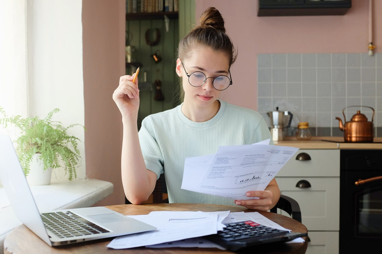 Finance Bill may affect the self-employed. Image of a freelancer doing her taxes