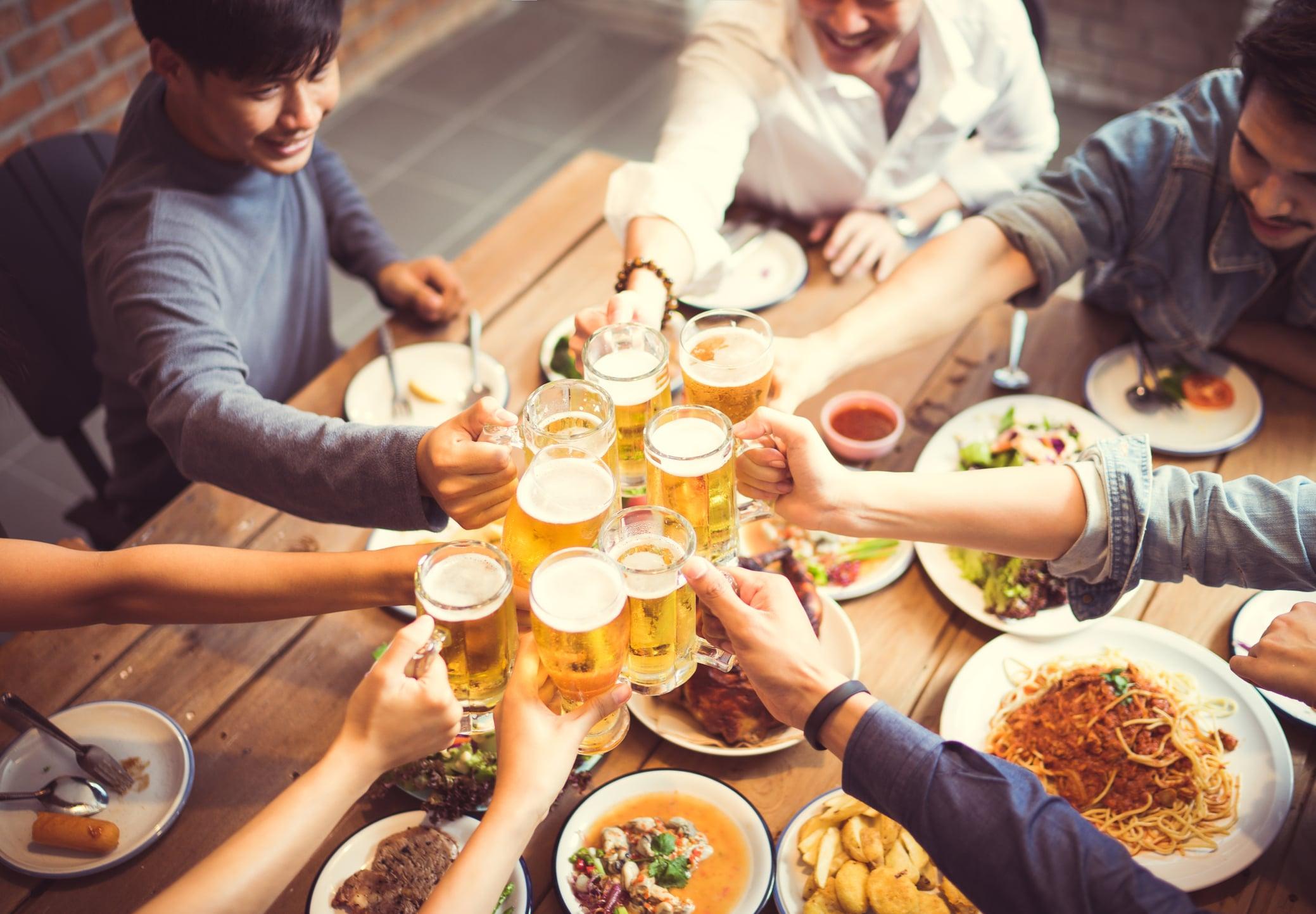 Friends raising a glass over dinner