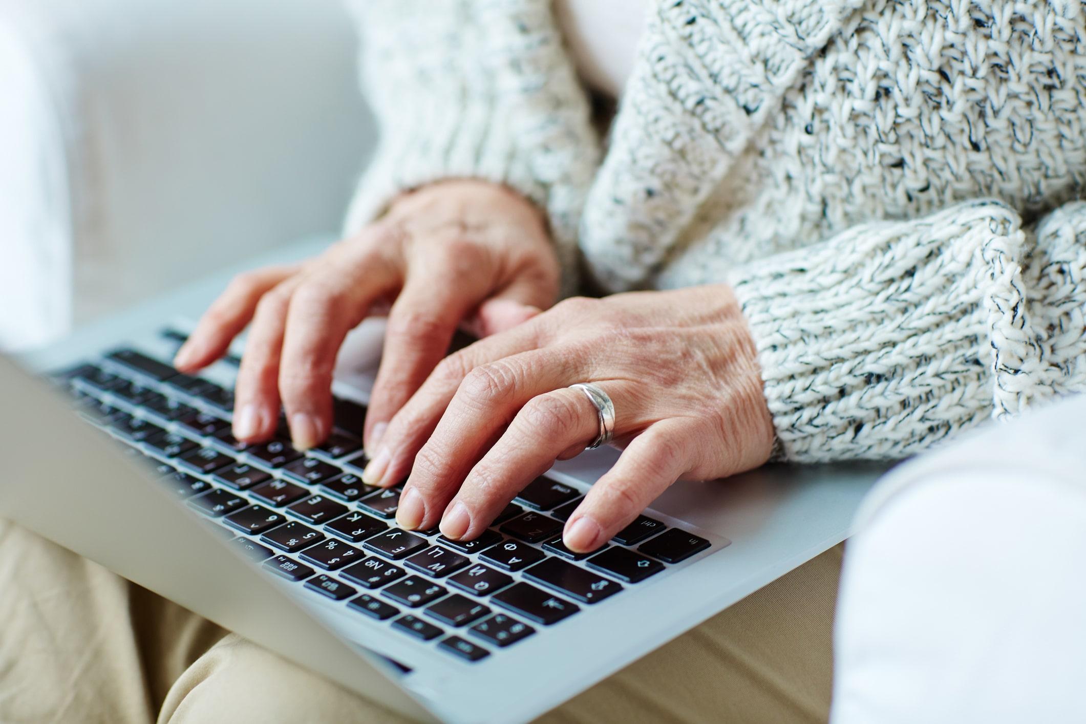 Pensioner using a laptop