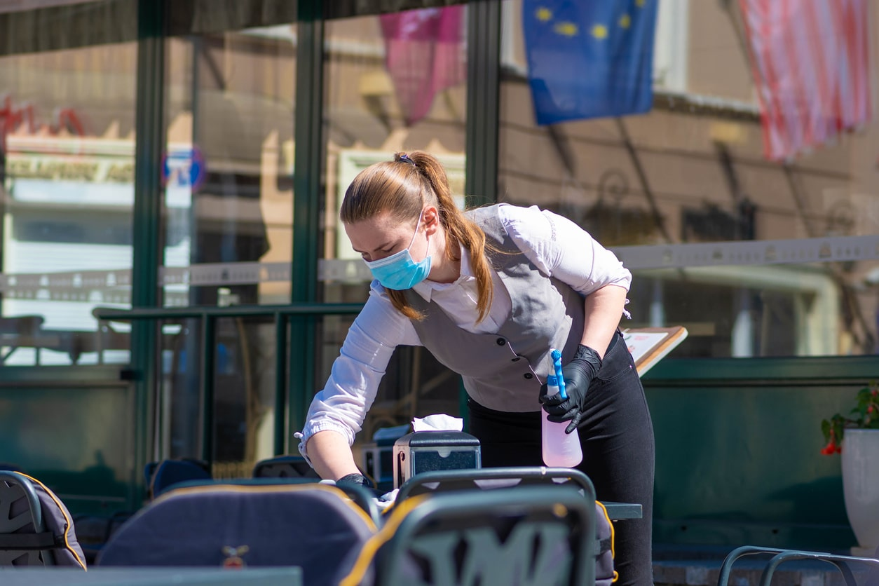 Summer economic statement by the Chancellor on 8th July 2020 - image of a worker cleaning tables