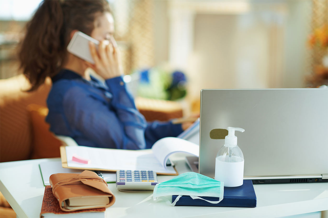 How a good mortgage broker can save you money during coronavirus, image of person using a phone in lockdown | Crunch