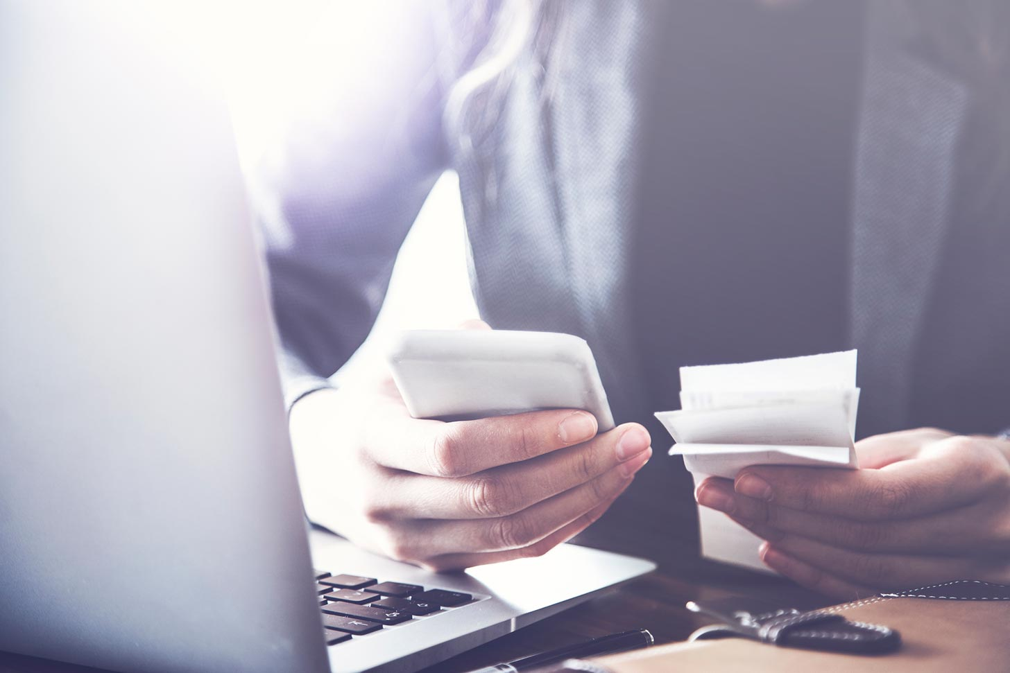 Managing business expenses: How to record, store and back-up your receipts, image of someone at a laptop | Crunch