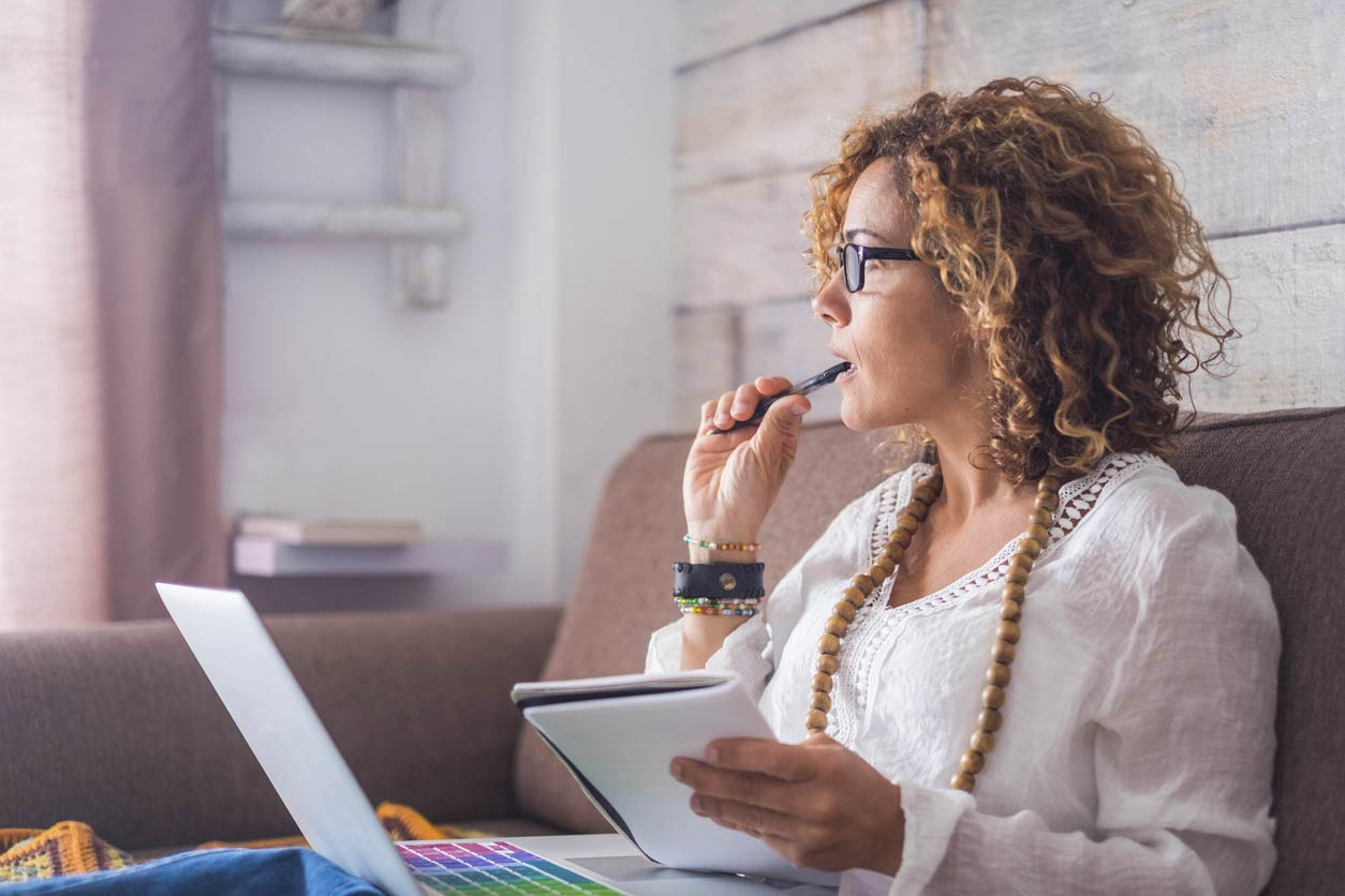 How to become a consultant, image of a woman at a laptop | Crunch
