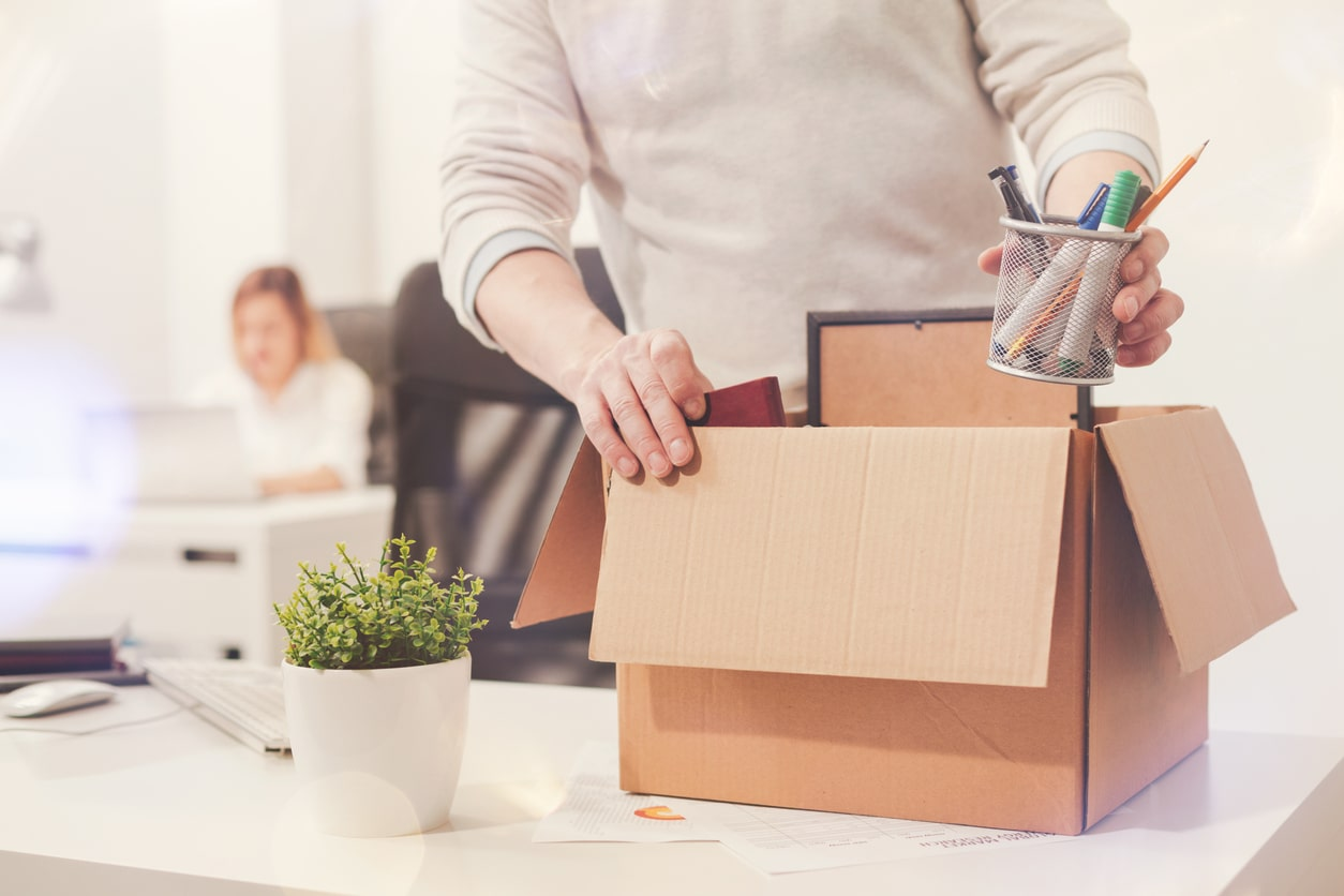 How your employment can come to an end - for employees. Image of someone packing up their desk | Crunch