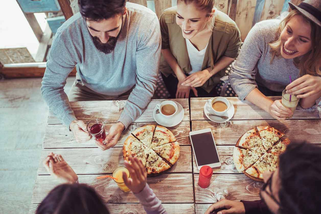 What is an Employment Related Securities Return, image of friends sharing pizza | Crunch