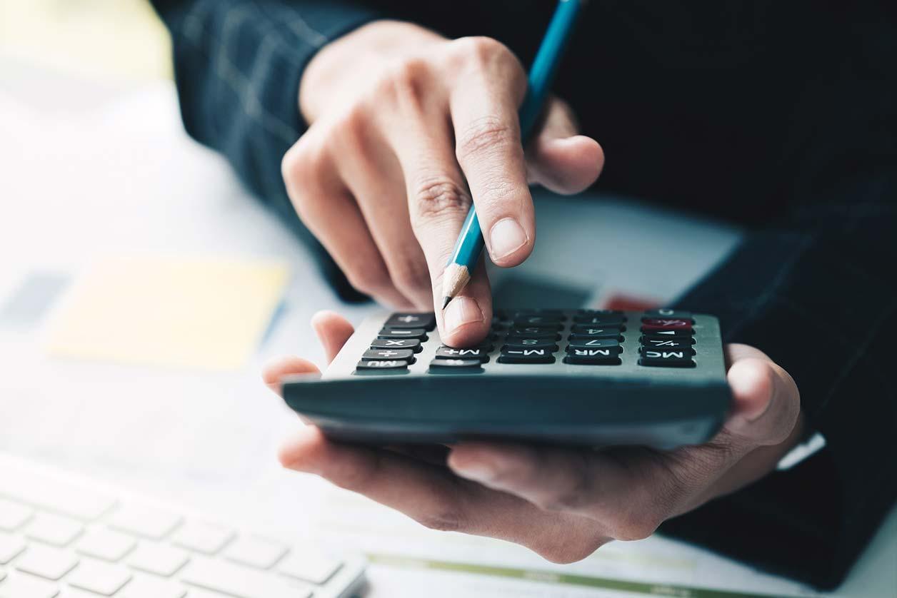 Helpful alternatives to cutting Corporation Tax, image of a calculator | Crunch