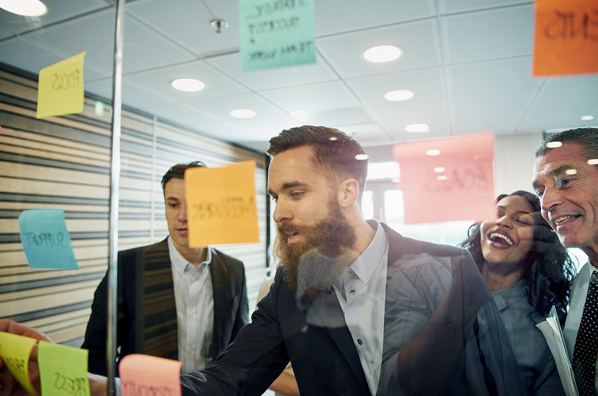 Sole Trader vs Limited company or umbrella - what's best. Image of a team of people working on a project | Crunch