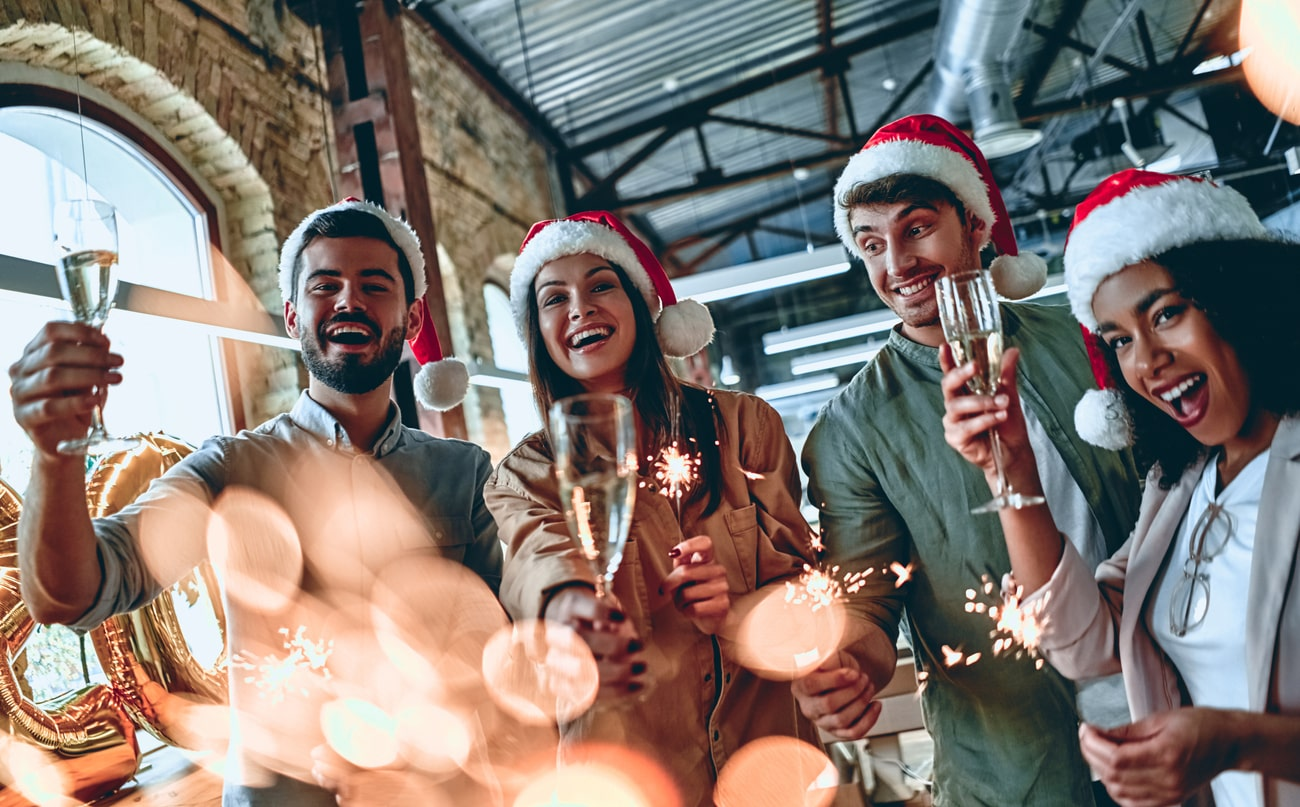 Should employers fear the office Christmas party? Staff misconduct outside the workplace Image of people celebrating Christmas | Crunch