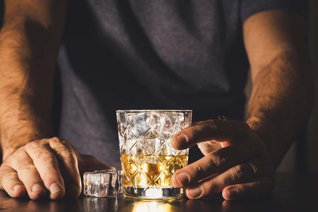Staff misconduct in the workplace, image of someone drinking alcohol | Crunch