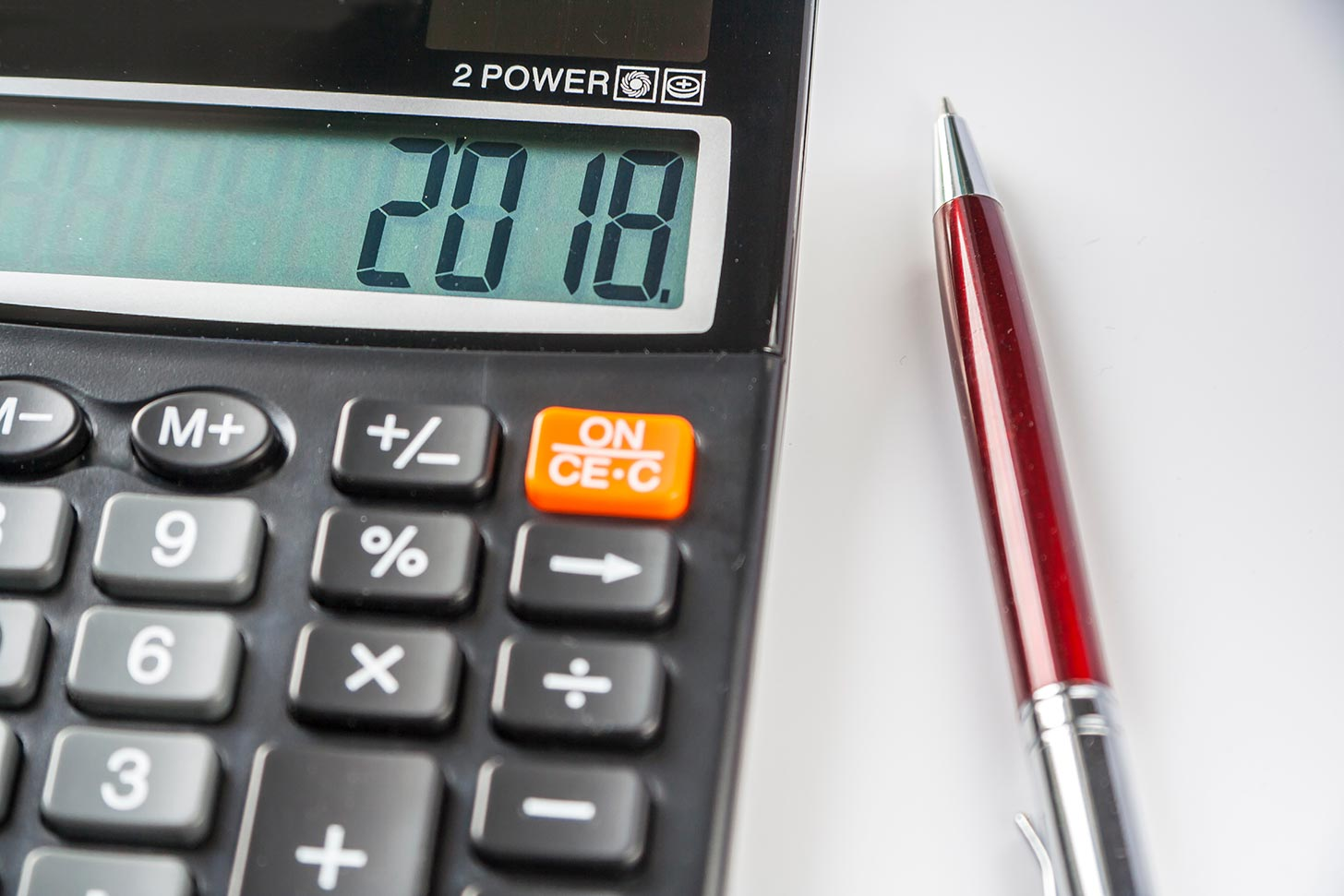 2018 Budget Highlights - How will it affect the self-employed and small businesses? Image of a calculator - Crunch