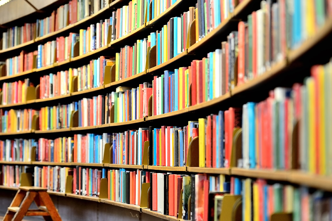 Gloassary of business terms - Crunch - image of books in a library