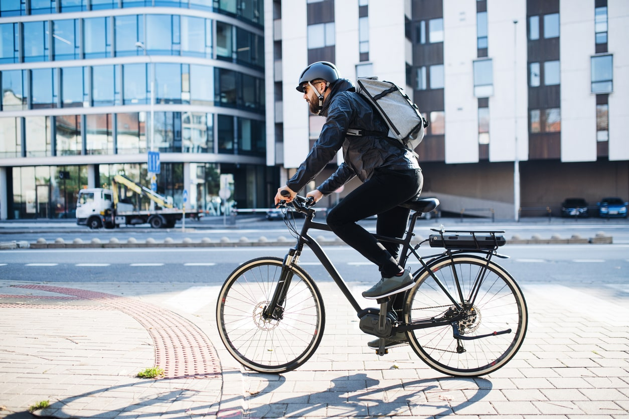CitySprint bike courier 'not genuinely self-employed'. Image of a cyclist in London
