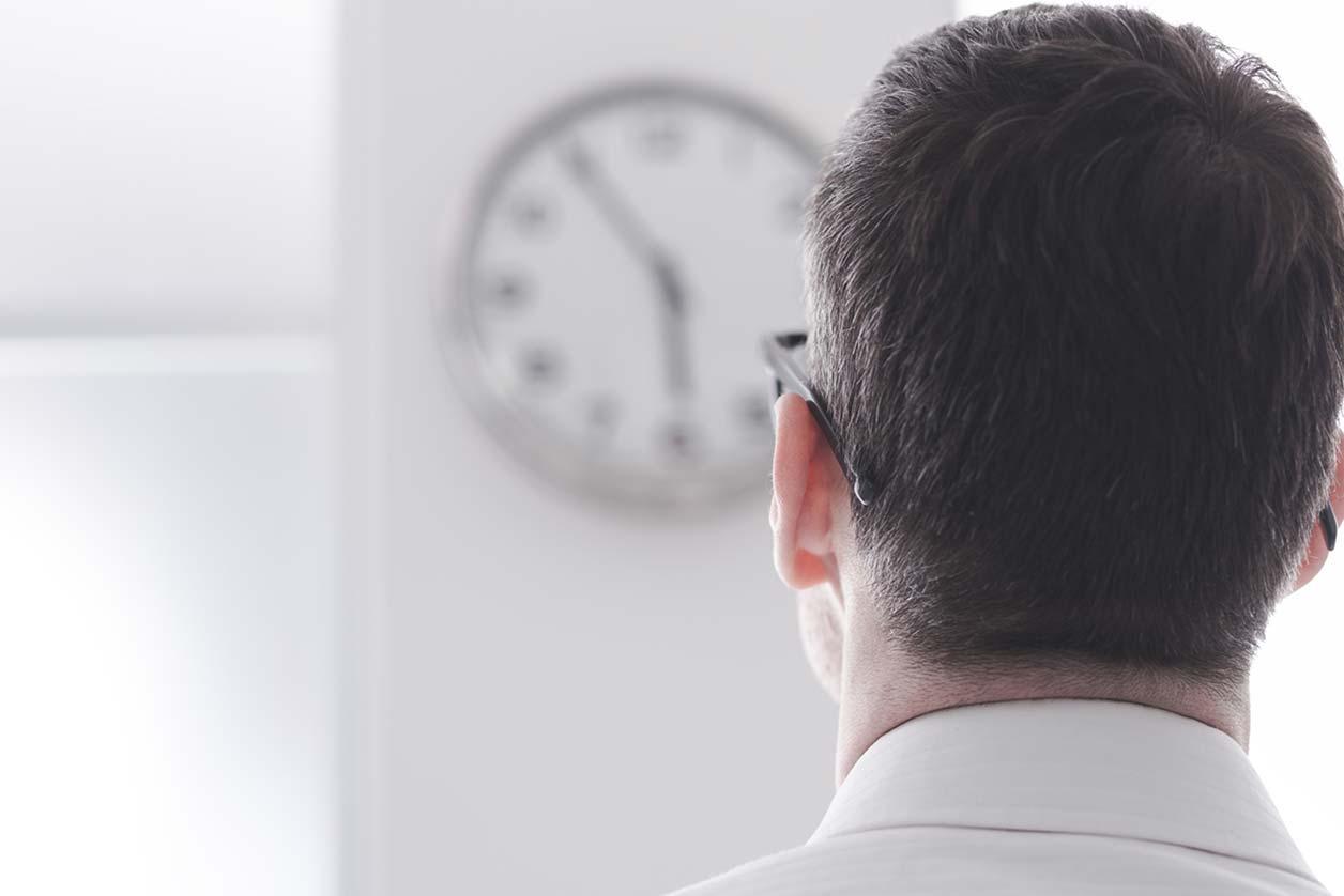 An office worker clockwatching