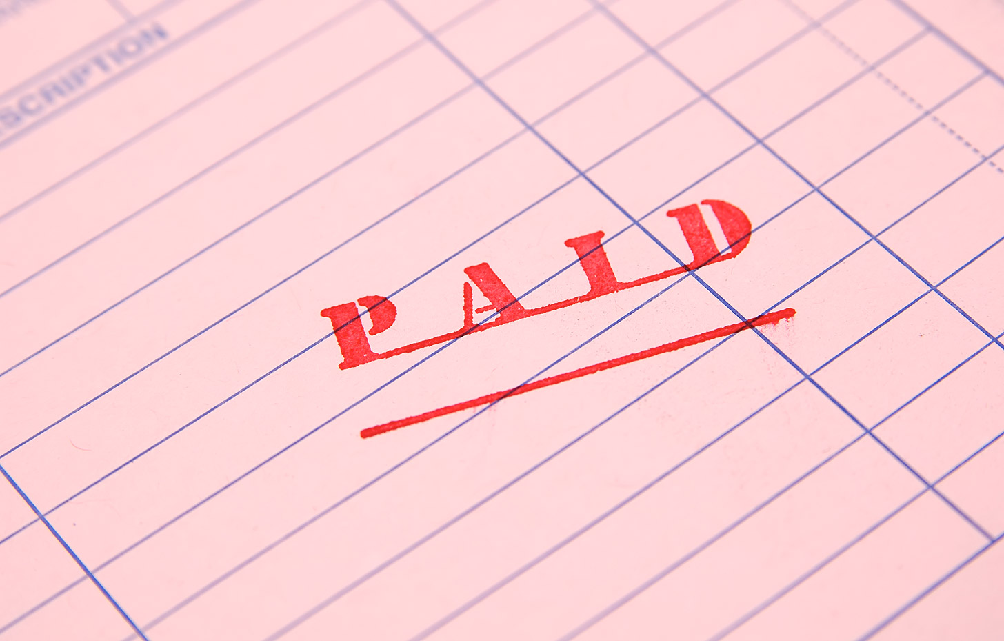 Seven debt collection myths debunked, image of a paid stamp | Crunch
