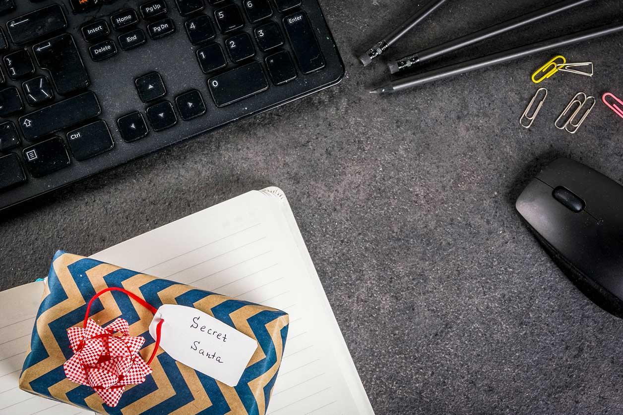 The worst Secret Santa presents ever, image of a Christmas present on a work desk | Crunch