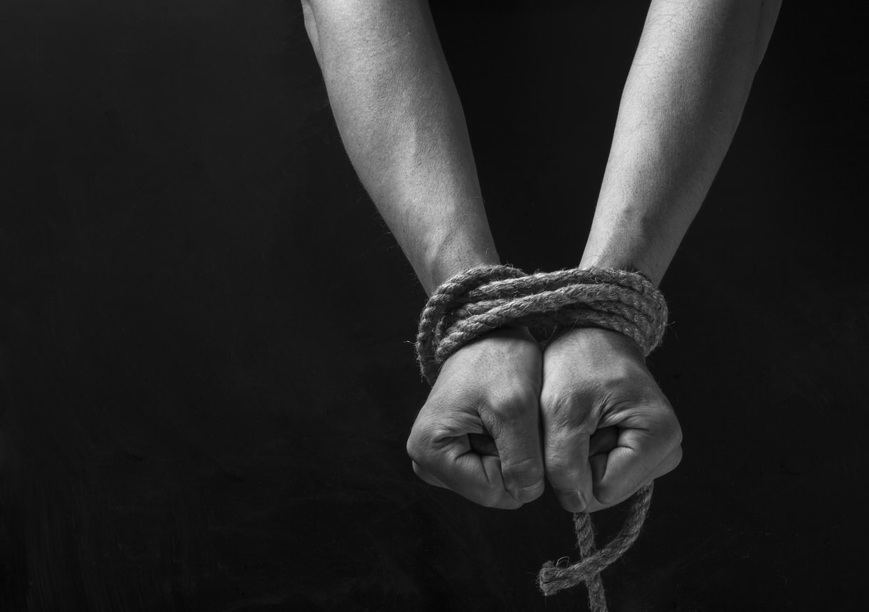 What does the Modern Slavery Bill mean for businesses? Image of someone with their hands tied