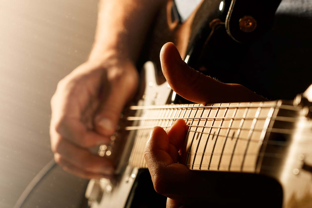 Can musicians make a living off Spotify?, image of a guitar | Crunch