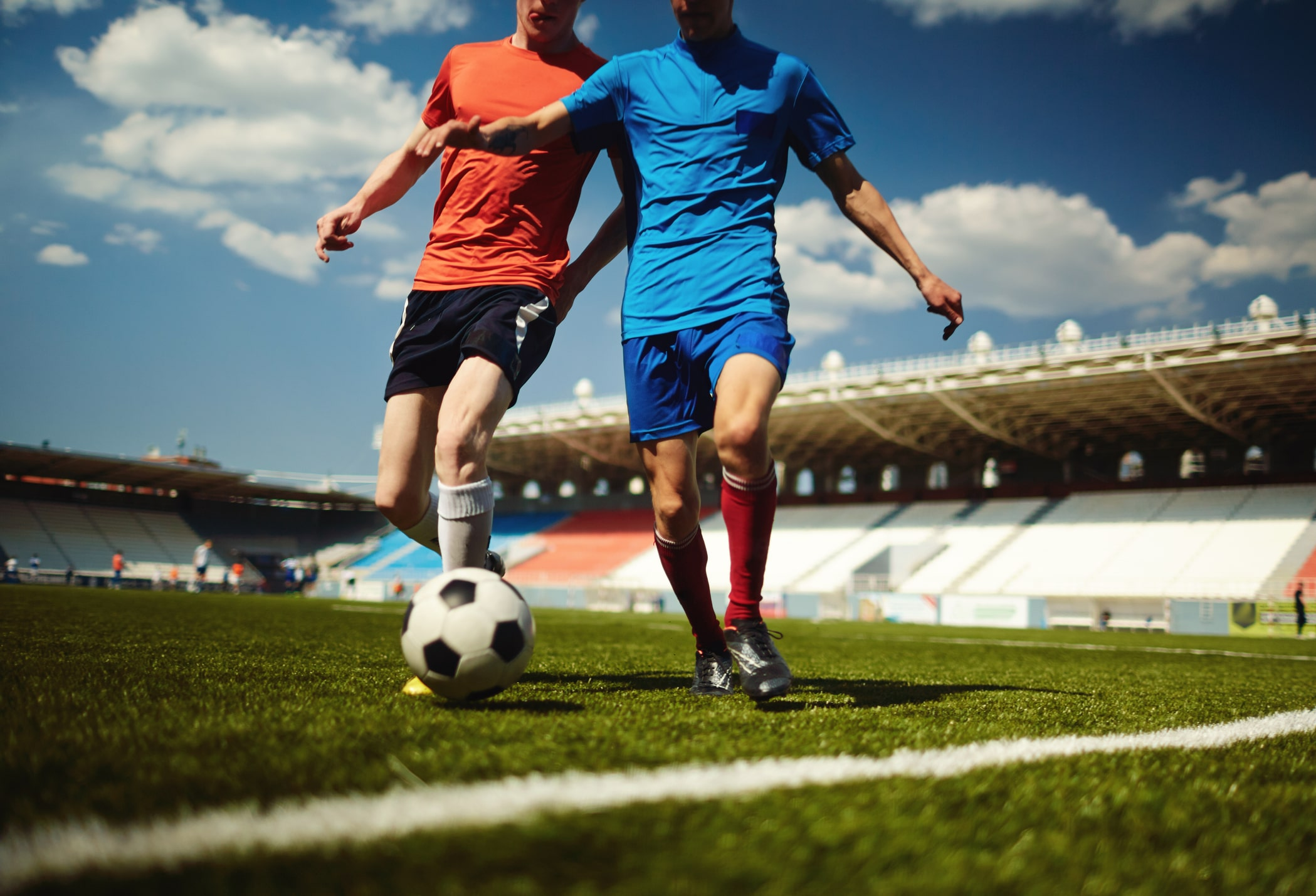 Two people playing football