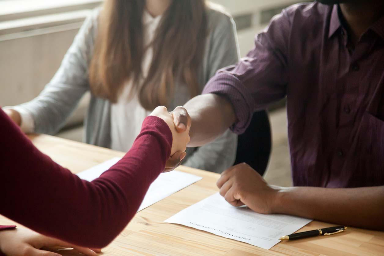 A handshake at a freelance recruiter