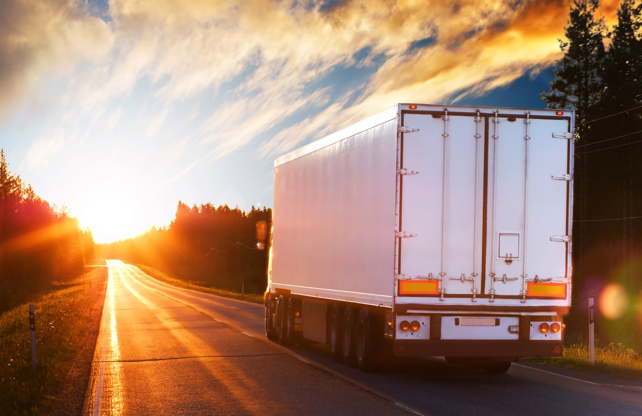Hours and rest breaks for UK goods vehicle drivers - Part 2. Image of a goods vehicle on the road | Crunch