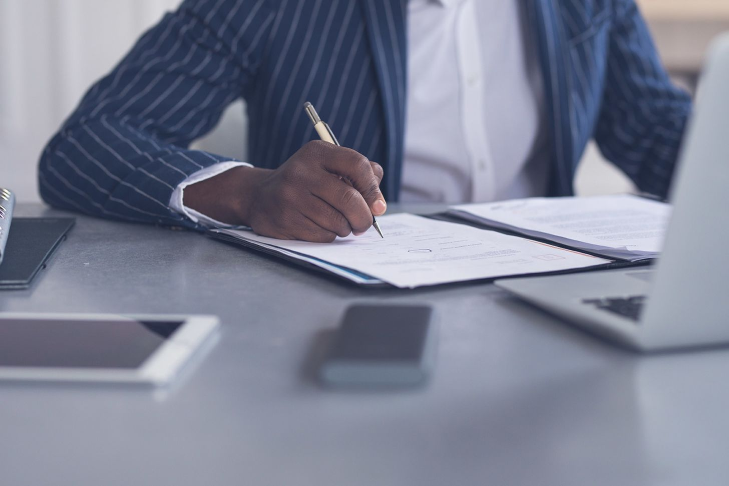 What are your rights if a client cancels your contract?, image of someone writing at a desk   Crunch