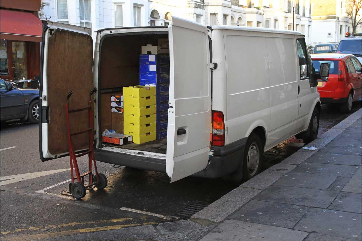 Should I have a company car, van or motorcycle?, image of open van | Crunch