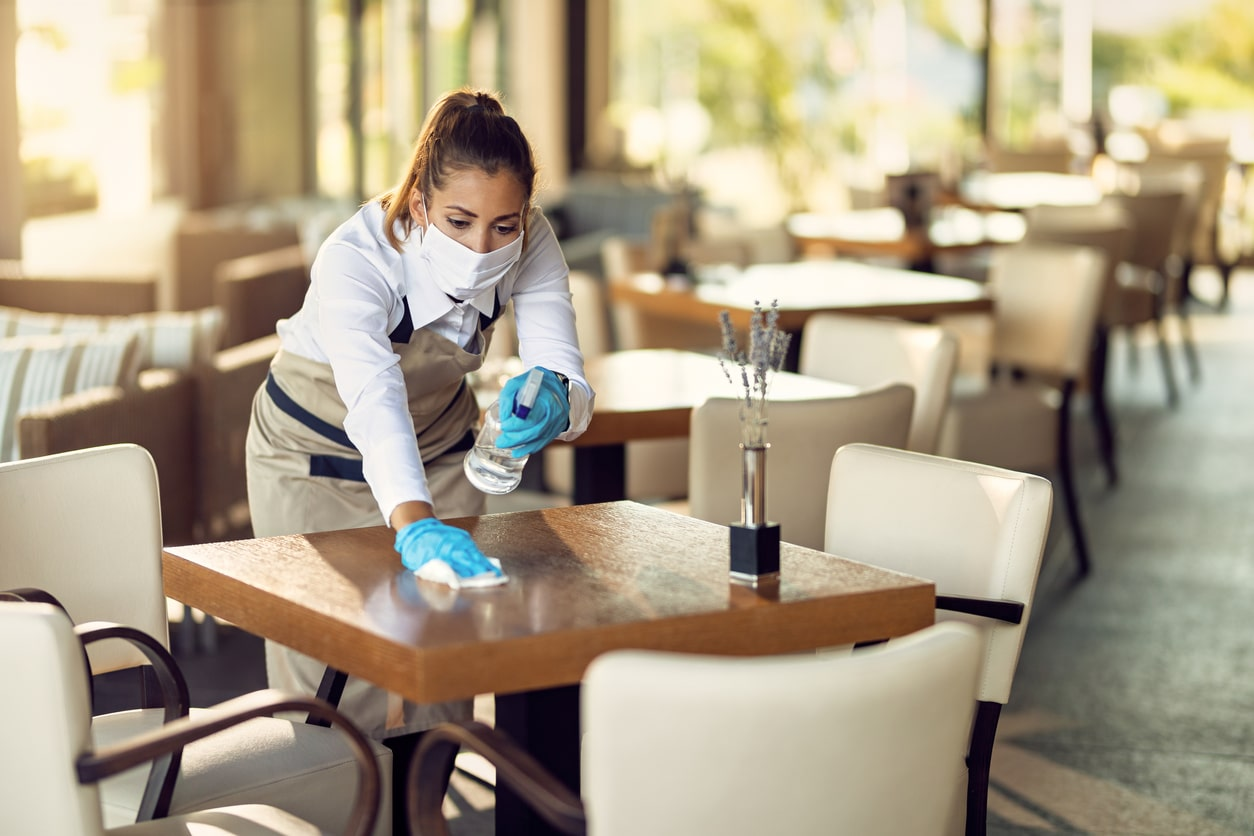 How to claim the fifth Self-Employment Income Support Scheme (SEISS) grant, image of someone wiping a table | Crunch