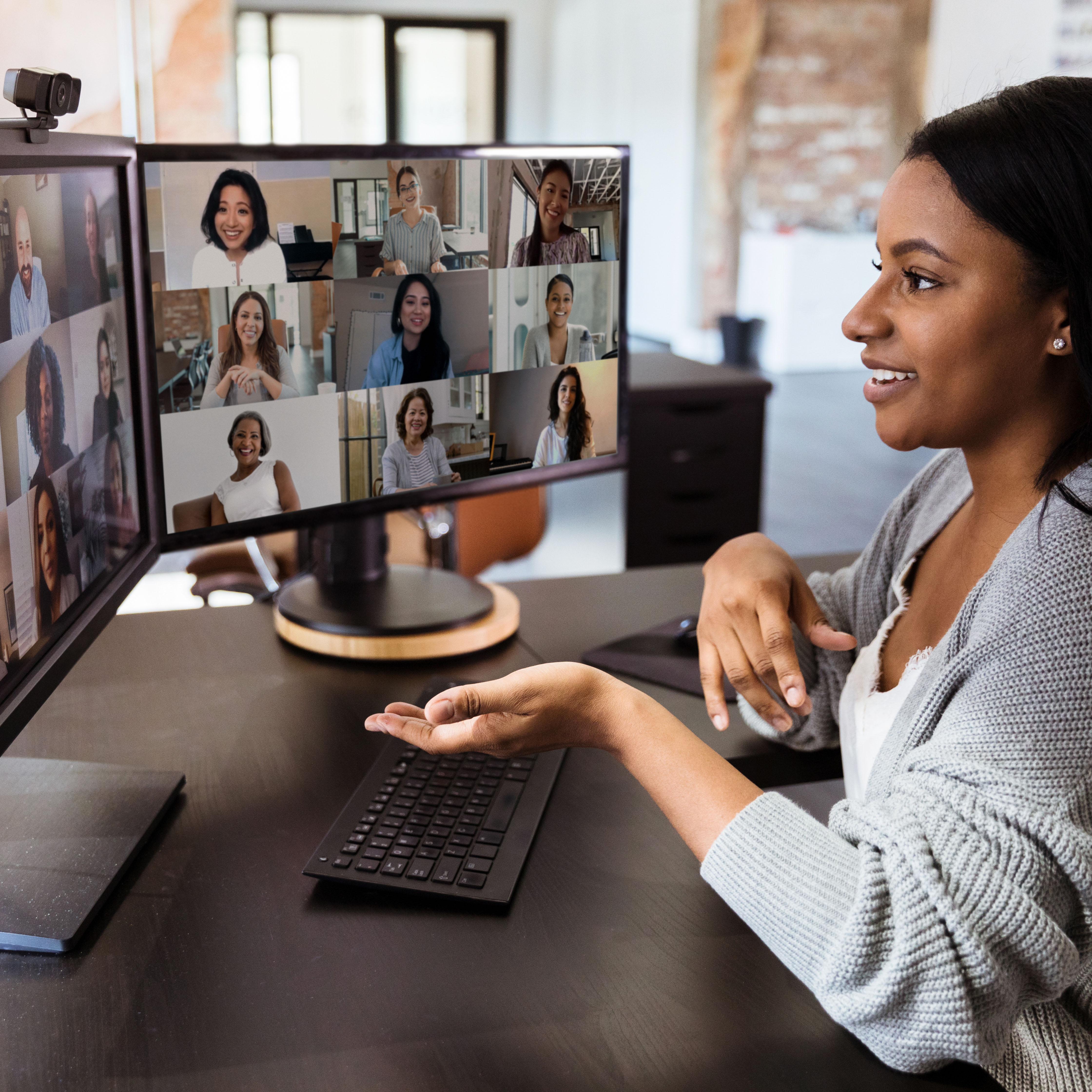woman looking at her 2 monitors