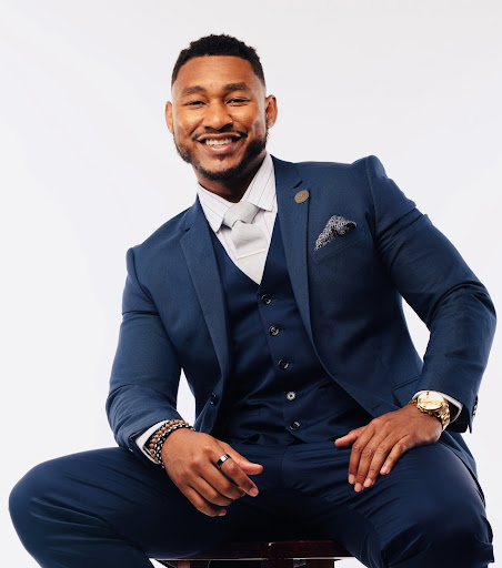 D'Angelo Taylor smiling wearing a suit
