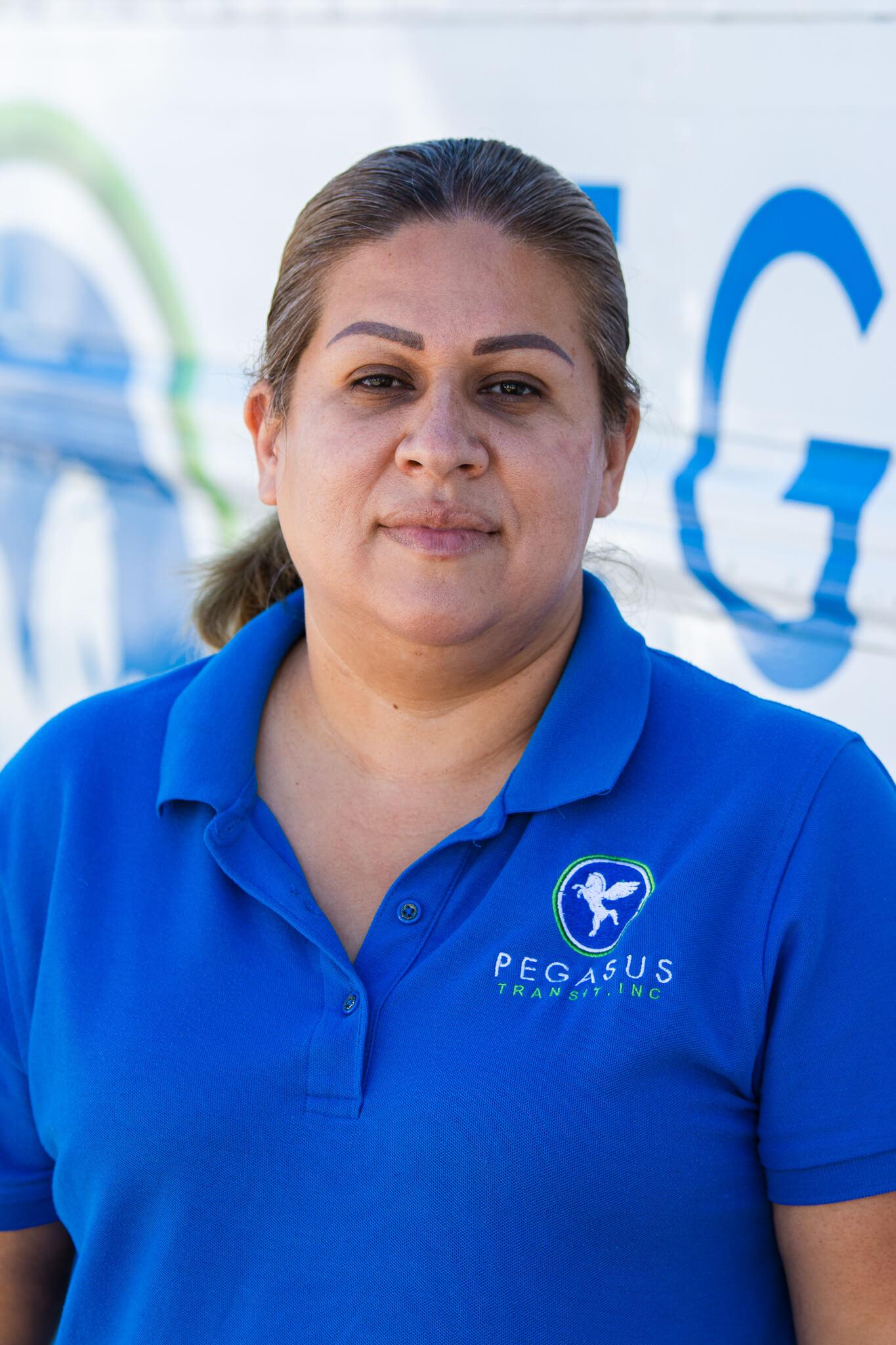 A portrait of a female Pegasus Transit bus driver.