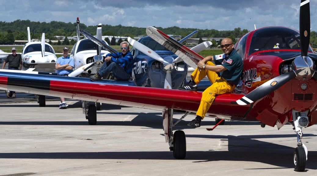Pictured: Adrian Eichhorn and Shinji Maeda resting on their aircraft