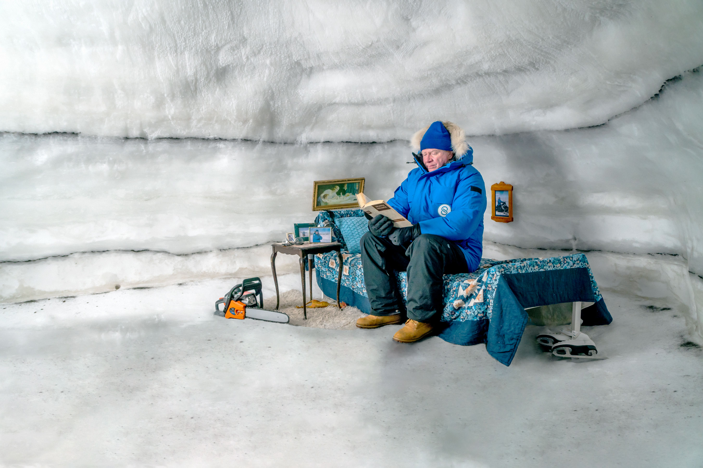 Siggi reading in an ice cave.