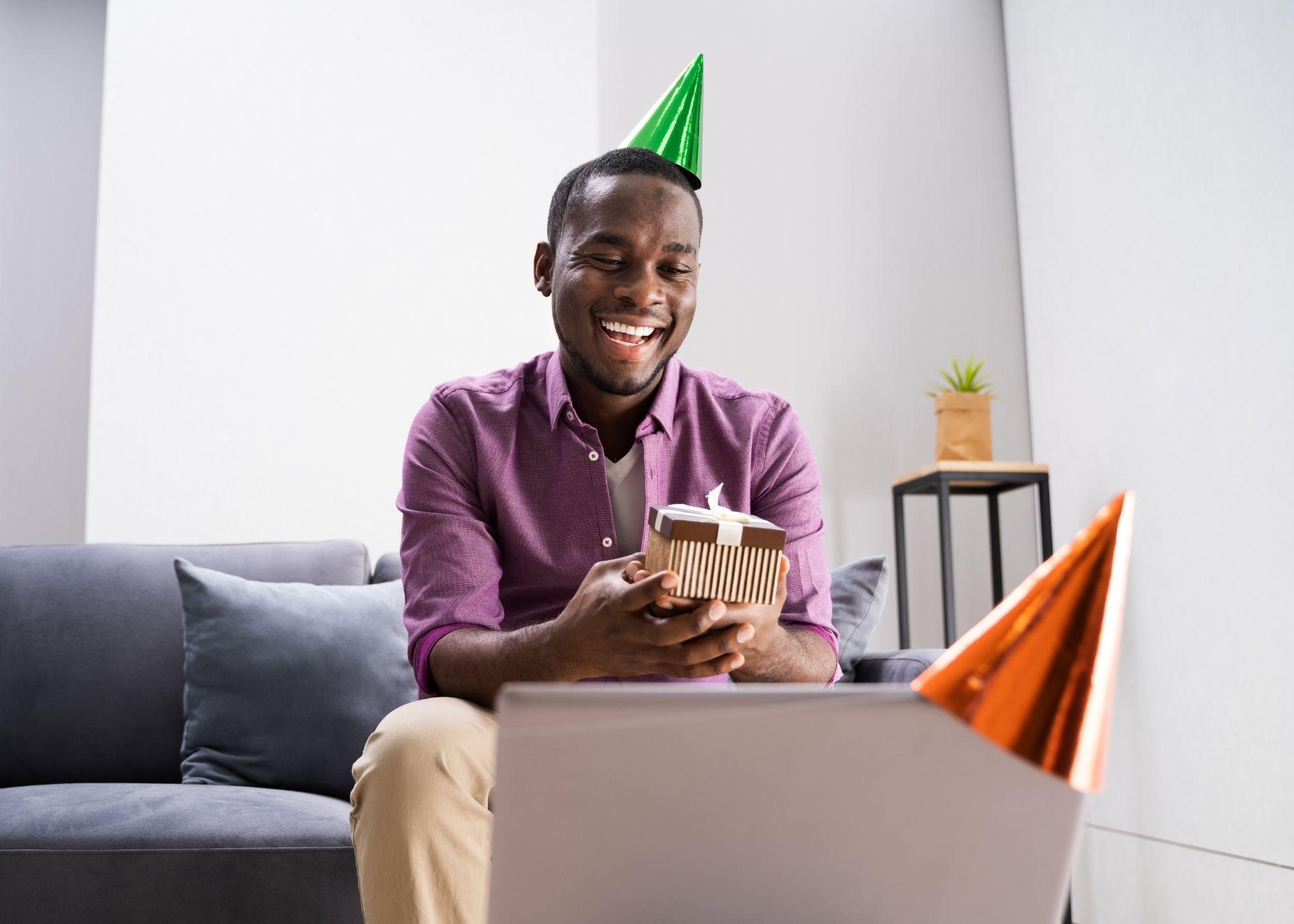 man watching birthday video
