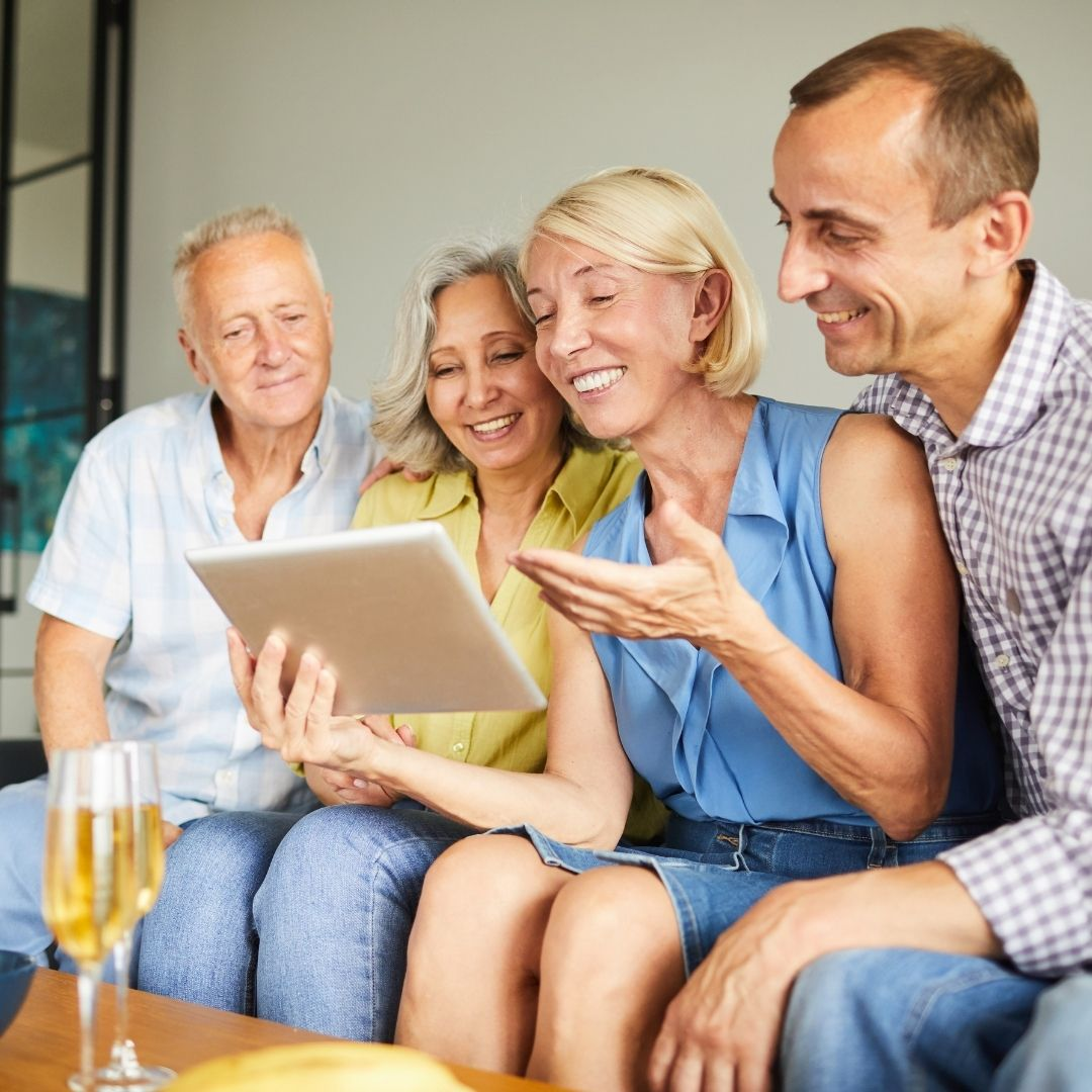 family watching video and smiling