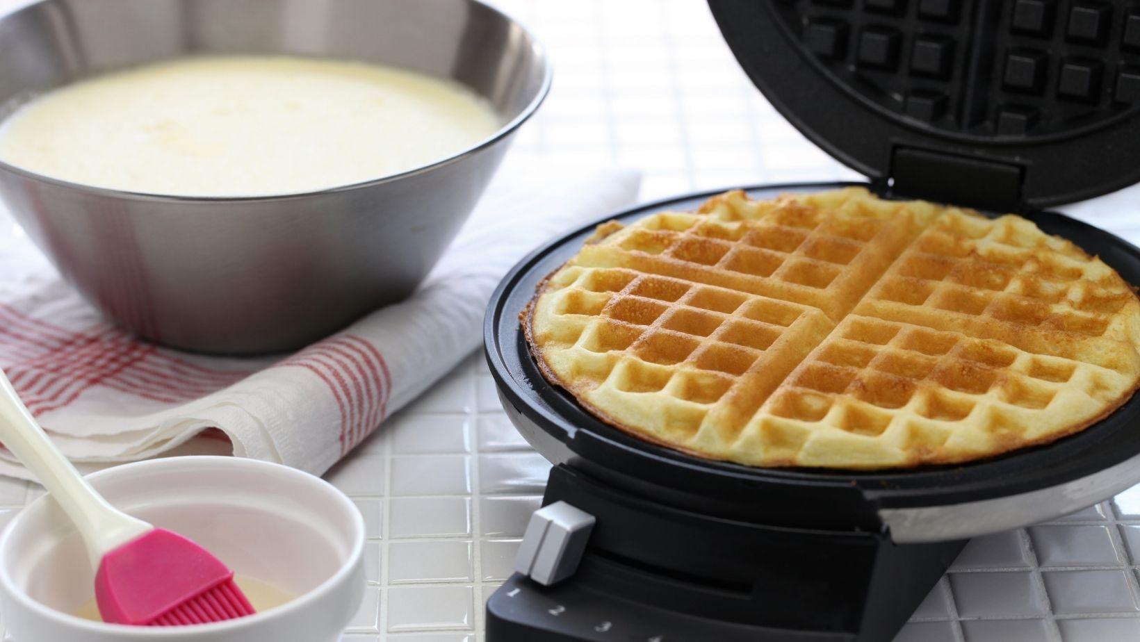 making homemade waffle on wafflemaker