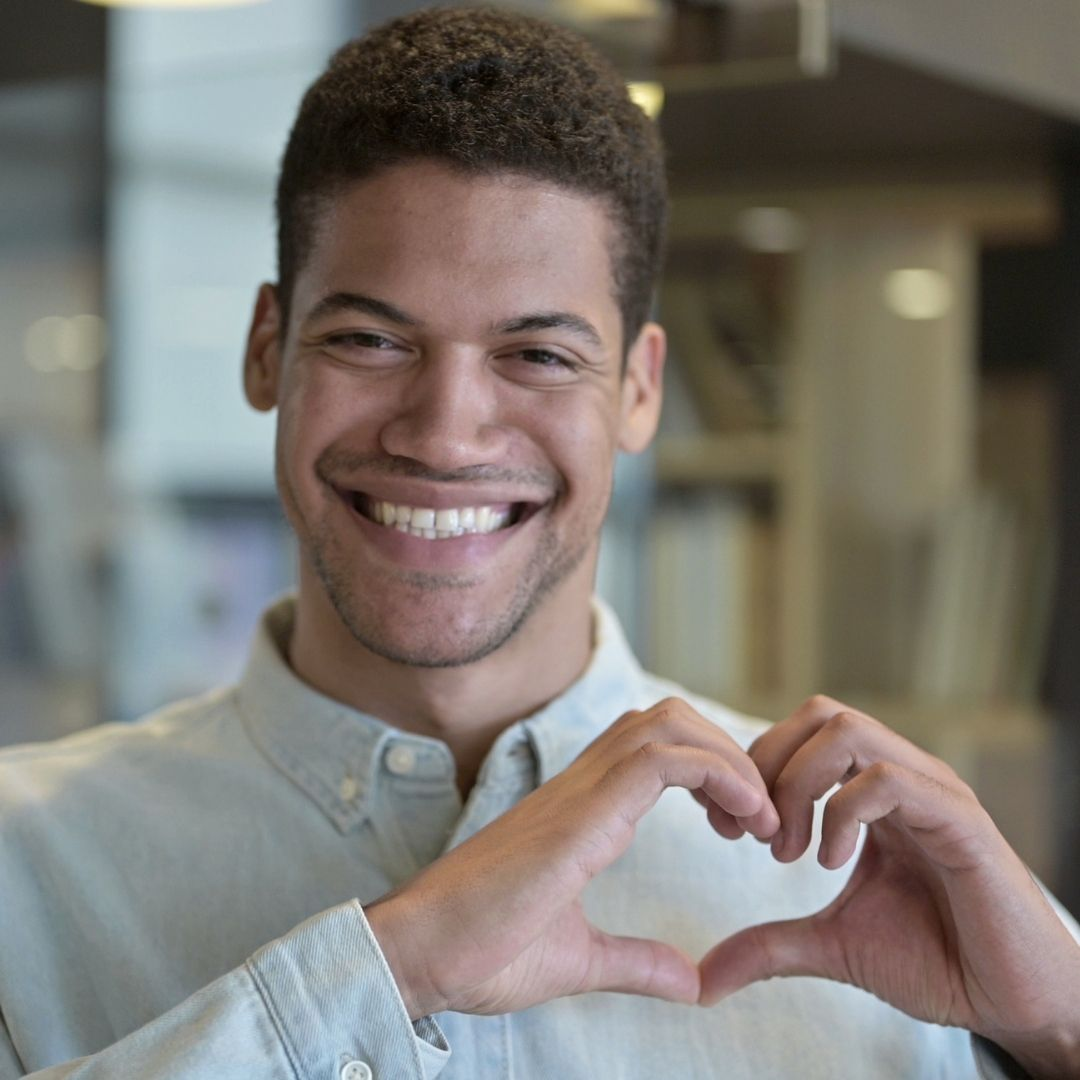 young man making heart with hands