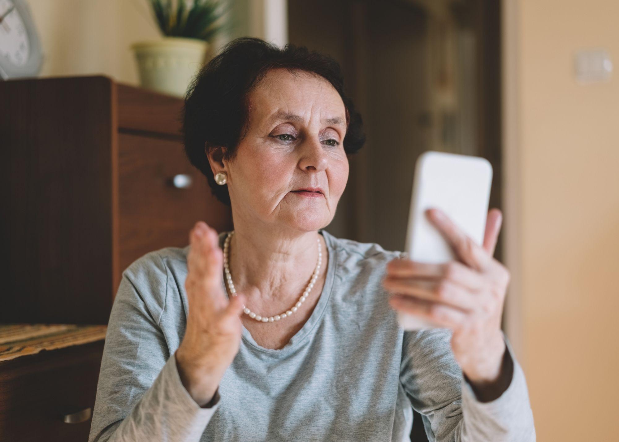 woman recording video on phone