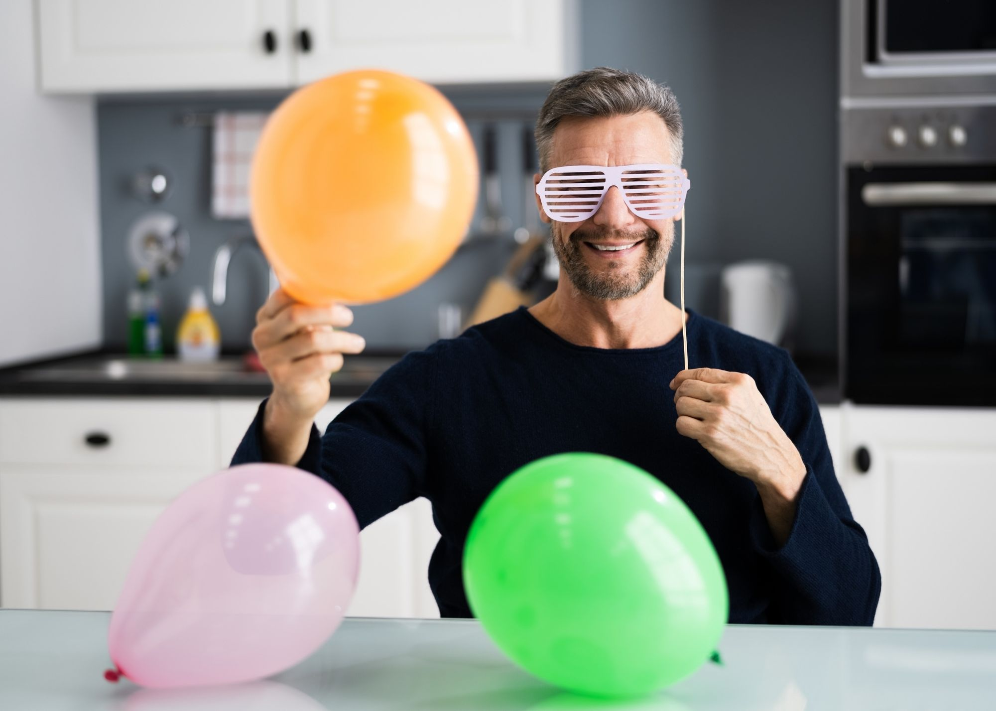 man with fun birthday props